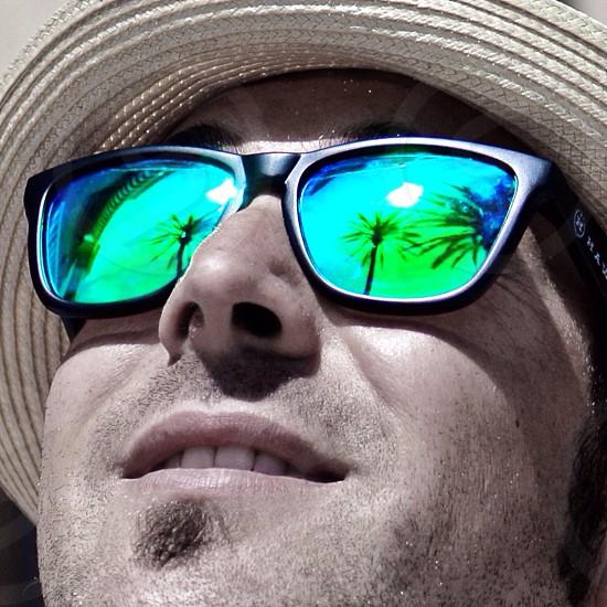 men starring in the sun wearing sunglasses photo