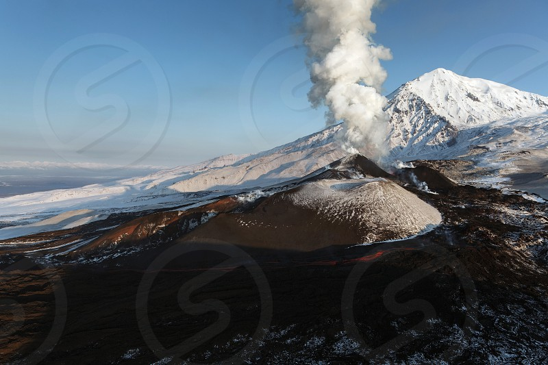 Beautiful nature of Kamchatka: eruption Tolbachik Volcano - effusion from the crater lava gas steam ash (view from helicopter). Eurasia Russia Far East Kamchatka Peninsula. photo