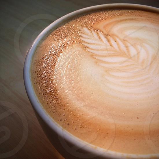 cappuccino in white ceramic mug photo