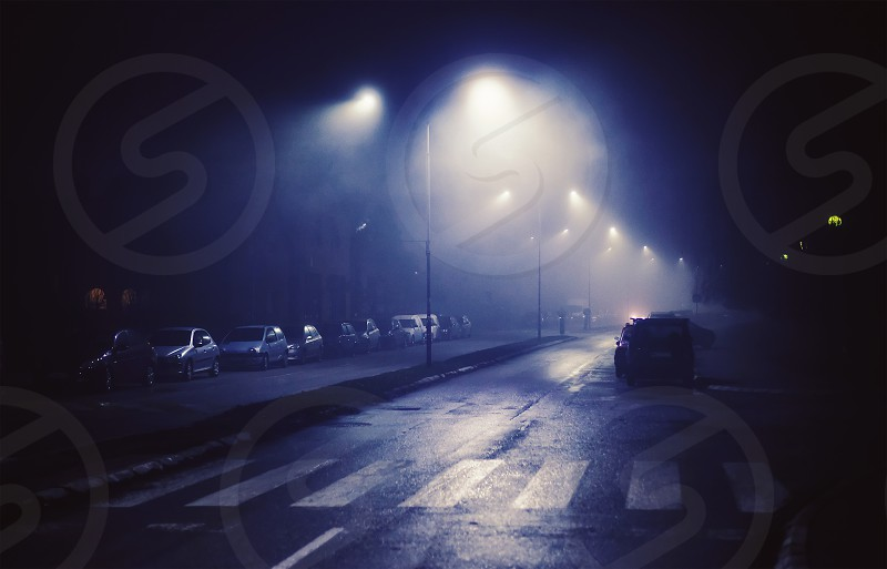 Night scene from small Balkan town foggy atmosphere.   photo