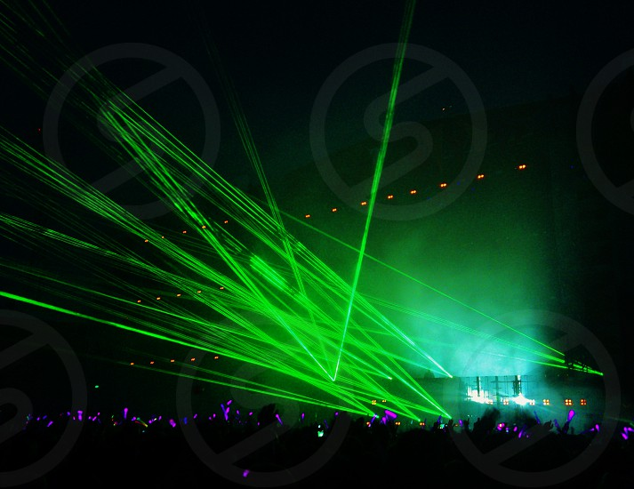 green strobe lights at a concert photo