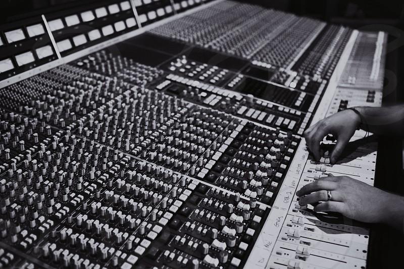 person using music mixer photo