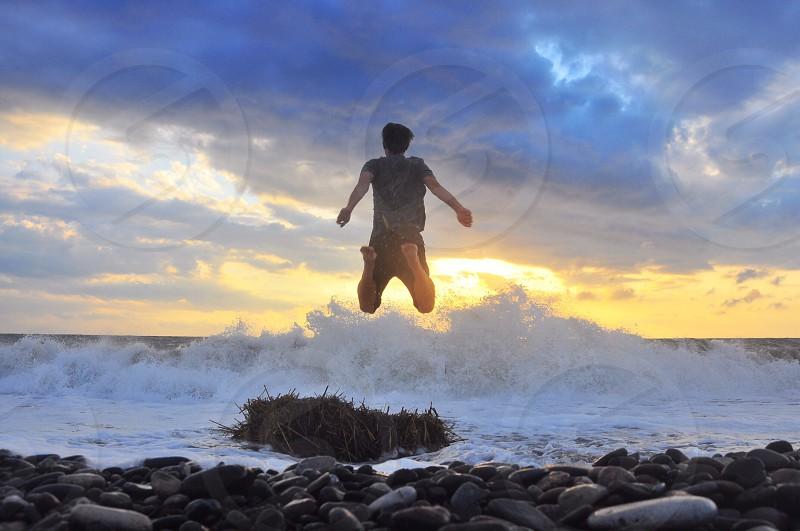 man in grey t shirt jumping photo
