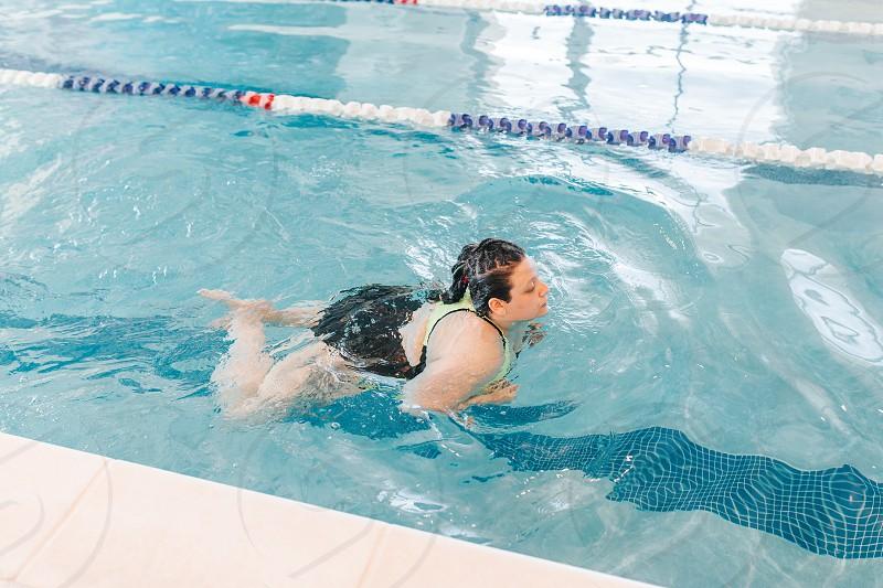 woman swimming in the pool photo