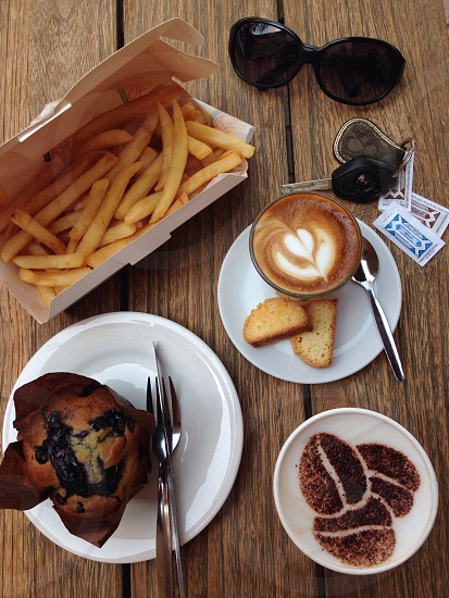 fries cappuccino and brown cupcake photo