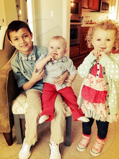 Babies bow ties & a polka dot cardi. photo
