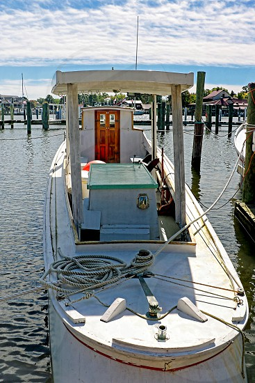Fishing boat is moored at a dock photo