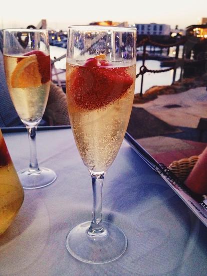Champagne cocktail sun sea strawberry photo