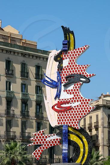 Roy Lichtenstein's Sculpture of a Face in Barcelona photo