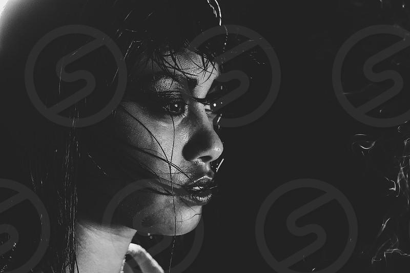 Rain wet high contrast black and white portrait photo