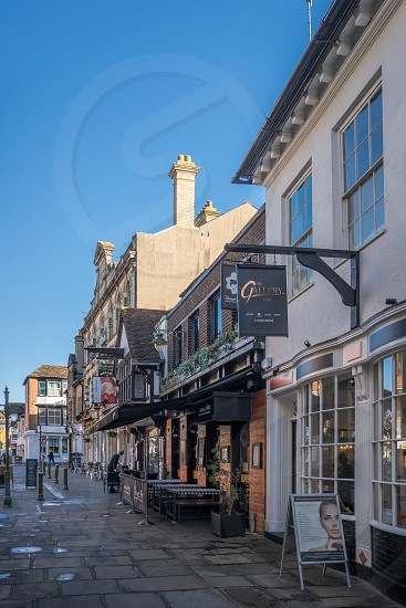 HORSHAM WEST SUSSEX/UK - NOVEMBER 30 : View of the town centre in Horsham West Sussex on  November 30 2018. Three unidentified people photo