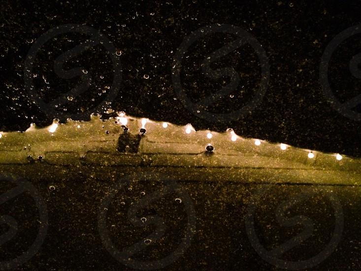 Christmas light reflection on carport rainy dark lights decoration photo