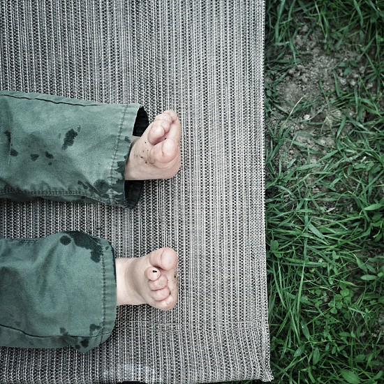 Baby kid feet dirty outside play lifestyle grass green photo