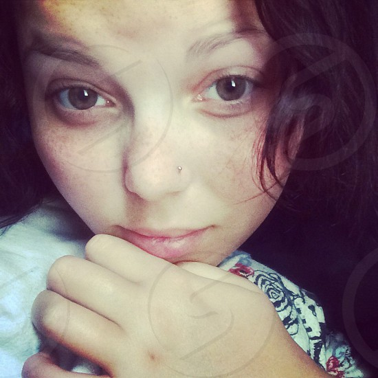 Fresh-face and all natural picture of a young woman with a nose piercing  photo
