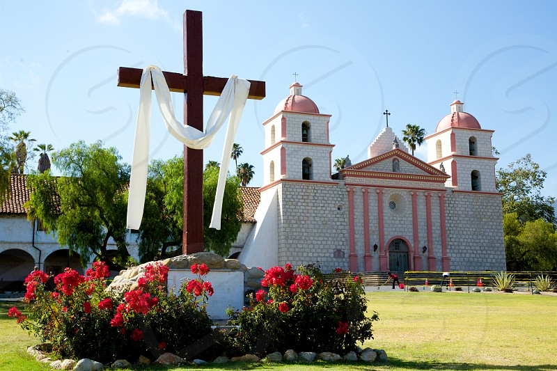white and pink cross with cross photo