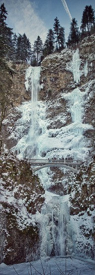 Multnomah falls winter  snow ice falls frozen freezing photo