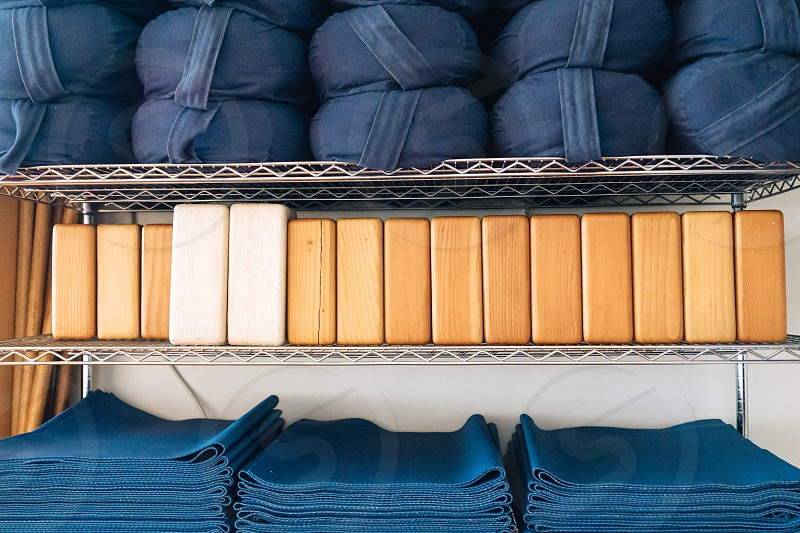 wooden blocks between black bags and blue textiles photo