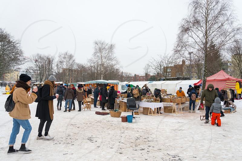 Activities of people and commodities at Mauerpark Flea market inside Prenzlauer Berg Neighborhood in Berlin Germany photo