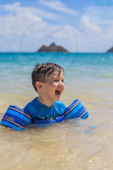 little boy swimming at the beach in Hawaii.  photo