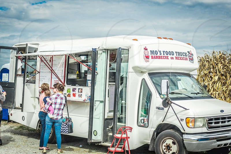 Food truck serving people at a farm festival. Street food on the go. photo