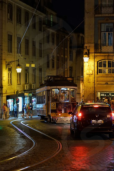 people riding tram during night photo