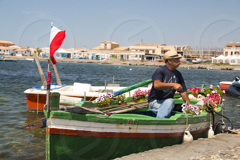 Man on the garden boat photo