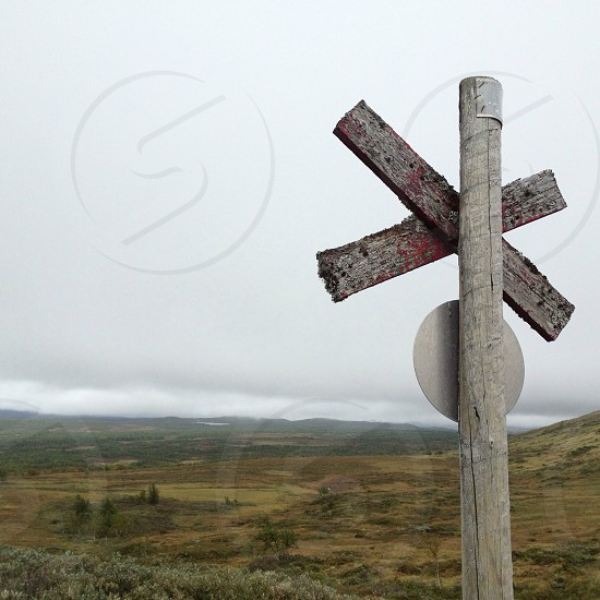 brown wooden road sign photo