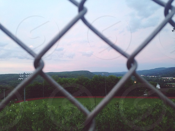 gray steel fence and green grass field photo