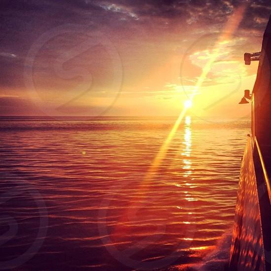 Summer sunset in open water. Ocean. photo