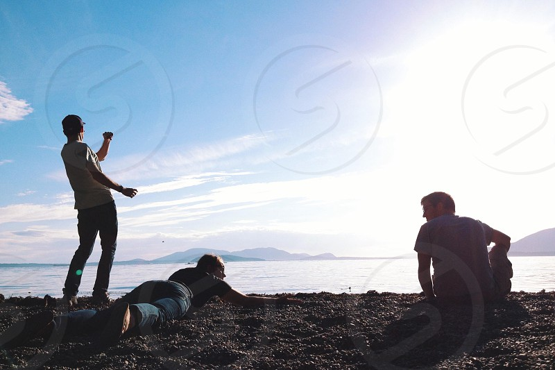 3 man on beach photography photo