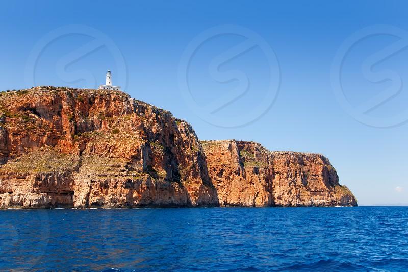 Formentera Faro de la Mola lighthouse view from sea photo