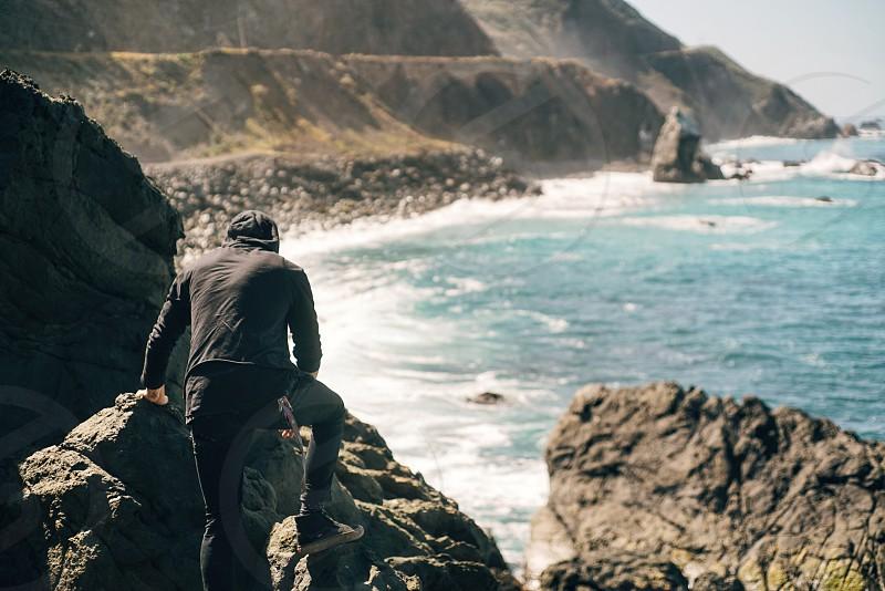 adventure; beach; coast; vacation; CA; California; freedom; guy; climb; search;  photo