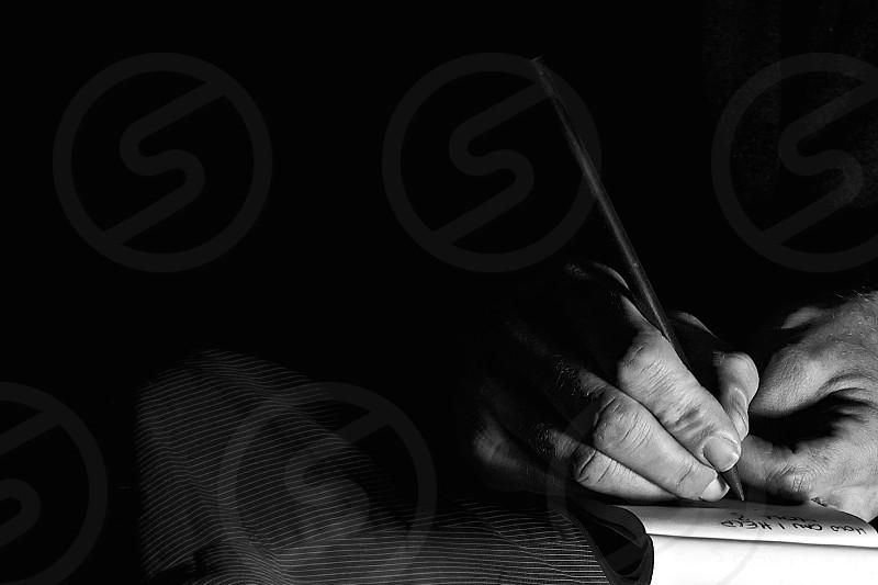 man holding pen photo