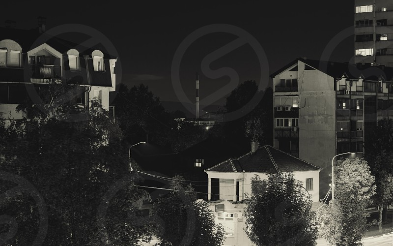 Town in Serbia during night in black and white.  photo