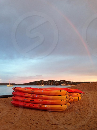 Orange canoes beach rainbow photo