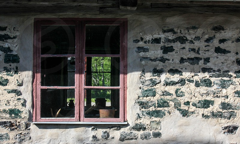 window at a very old building from the 1800s in a small town named Langvindsbruk on the middle north of Sweden know as a touristic attraction in midsummer   photo