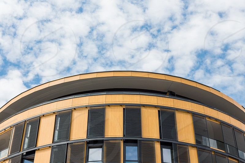 Top of orange and brown building and blue sky photo
