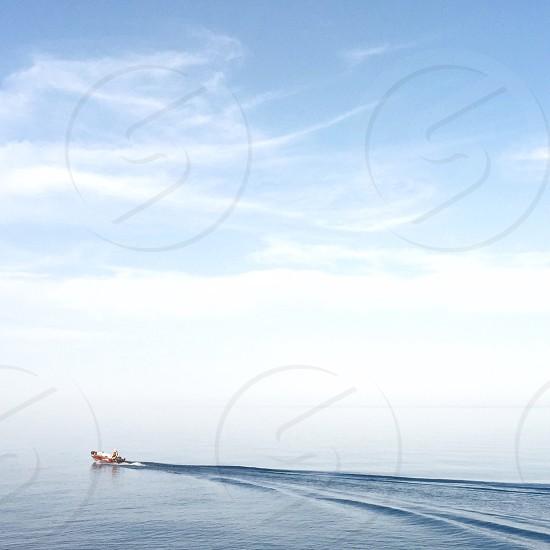 person playing jet ski during daytime photo