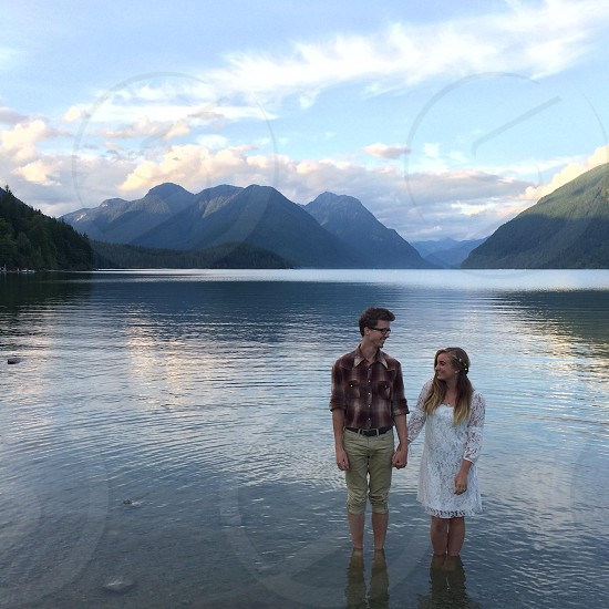 couple on body of water photo