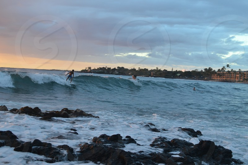 man surfing with waves photo
