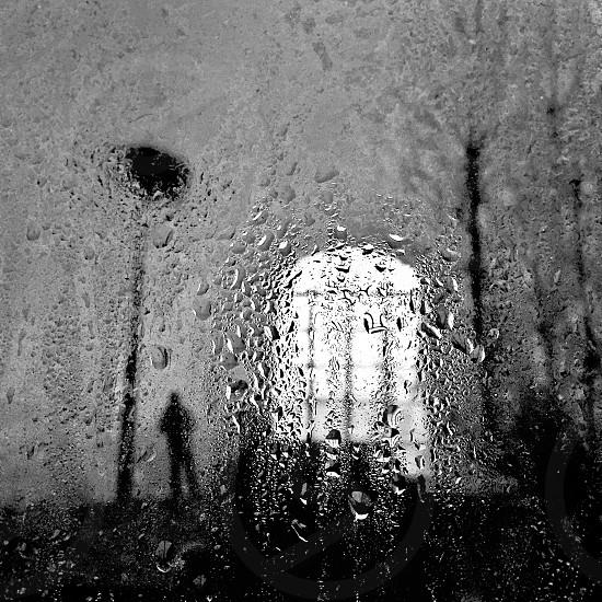 man rain rainy rainy day window reflections moody dark autumn fall noir black and white landscape melancholic melancholy sad sadness alone lonelyness one wet raindrops photo