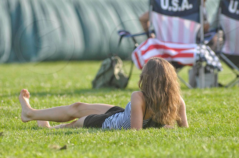 Woman portrait relaxing resting grass field concert single one person.   photo