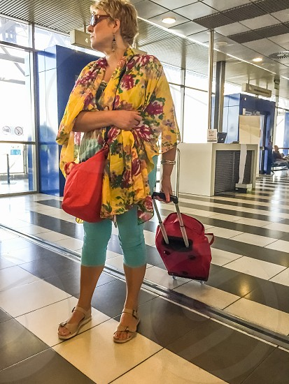 Woman Traveler With Luggage At The Airport photo