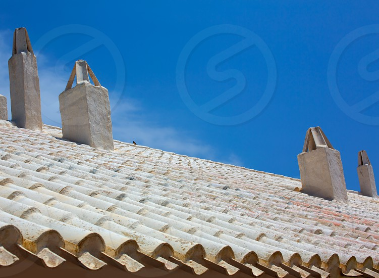 Binibequer Vell in Menorca White roof chimney Sant Lluis at Balearic Islands photo