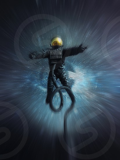 Astronaut absorbed by the cosmic eye. Collapse into nothing as cosmonaut is moving on light speed attracted by the gravity of an unknown galaxy. Inspired by Pioneer statue Leicester Space Centre UK. photo