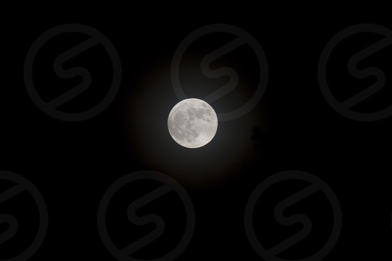 Full moon isolated against dark sky photo