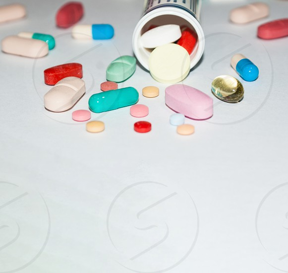 the pharmaceutical pills were spilled on the laboratory counter photo