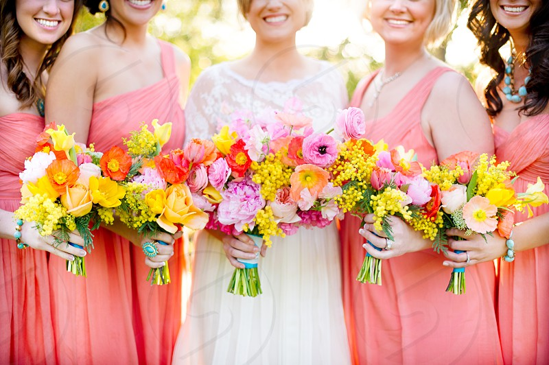 Bride and bridesmaids with flower bouquets  photo