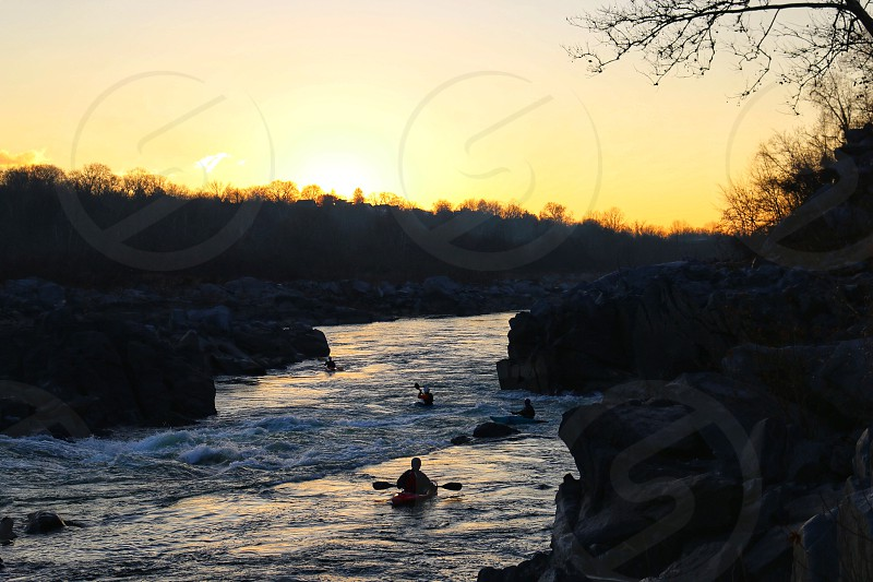 Kayakers finishing a morning run at Little Falls of the Potomac River right outside Washington DC. photo