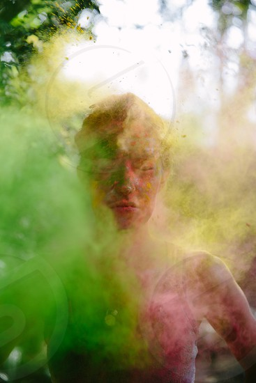 woman with green smoke and body paint portrait shot  photo